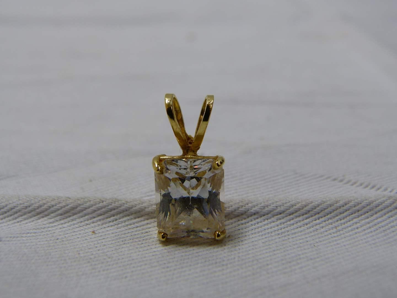 Lot # 231  Guaranteed 14K gold pendant with large CZ (main image)