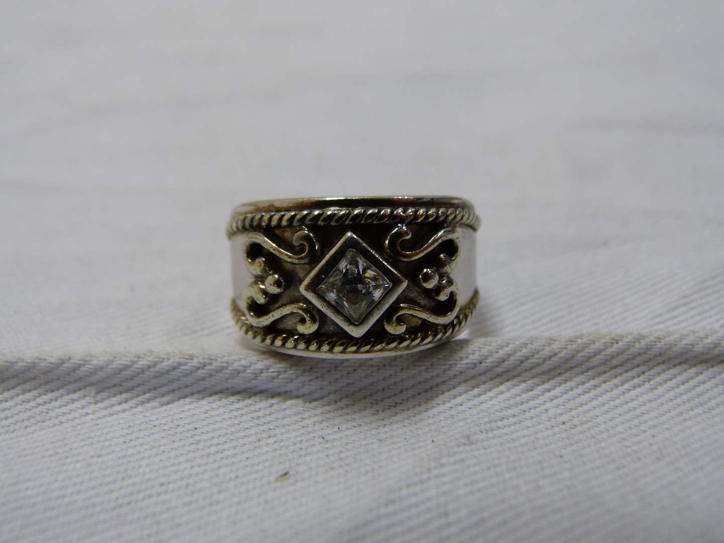 Lot # 236  Sterling silver and CZ size 8 ring