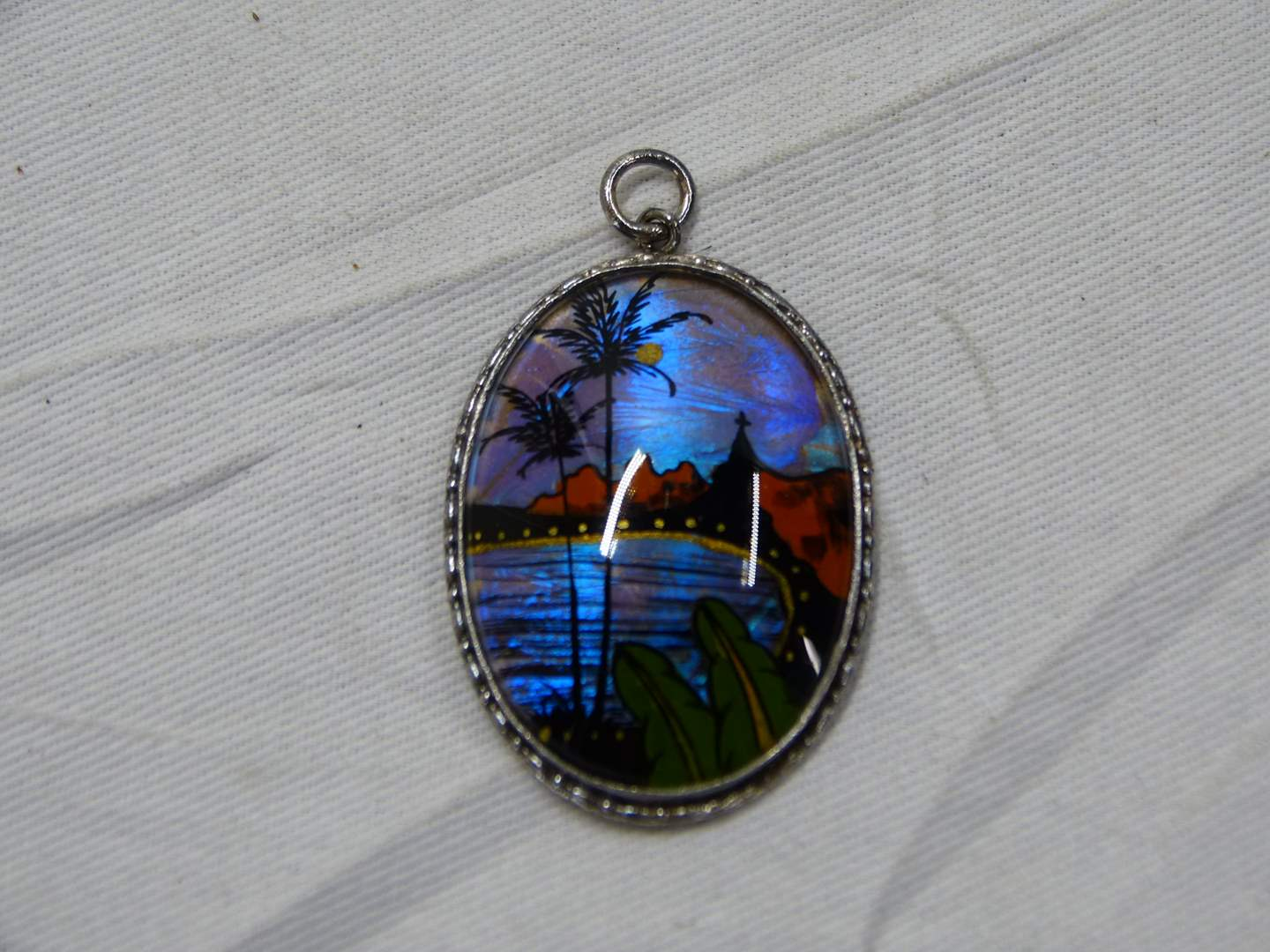 Lot # 248  Reverse painted on glass sterling silver pendant (monogrammed)