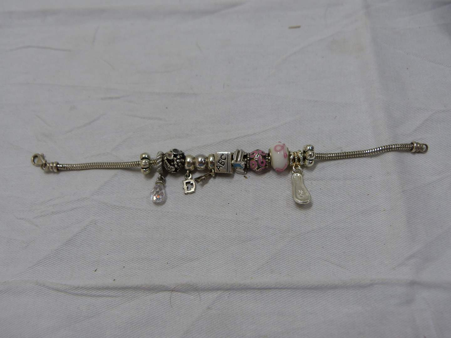 """Lot # 250  Sterling silver baby (Pandora style) bracelet to include 14K gold shoe 8"""" (main image)"""