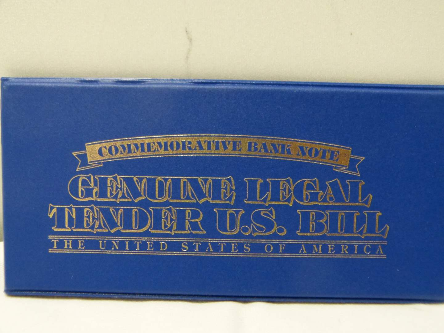 Lot # 274  Genuine Legal Tender painted $2.00 bill in protective case (main image)