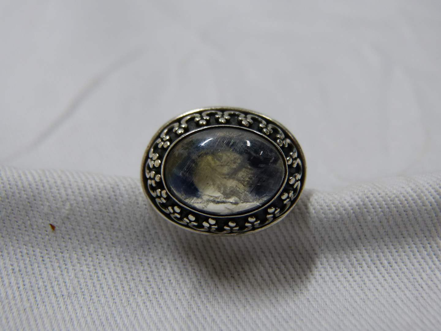 Lot # 290  Signed sterling silver moonstone size 7 (has a bell inside)