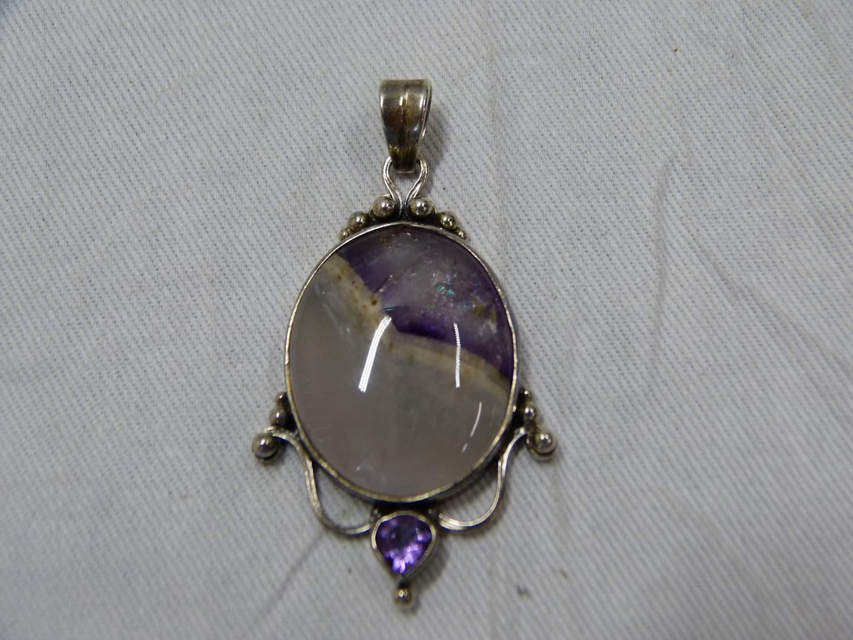 Lot # 296  Beautiful sterling silver & purple stone drop pendant (main image)