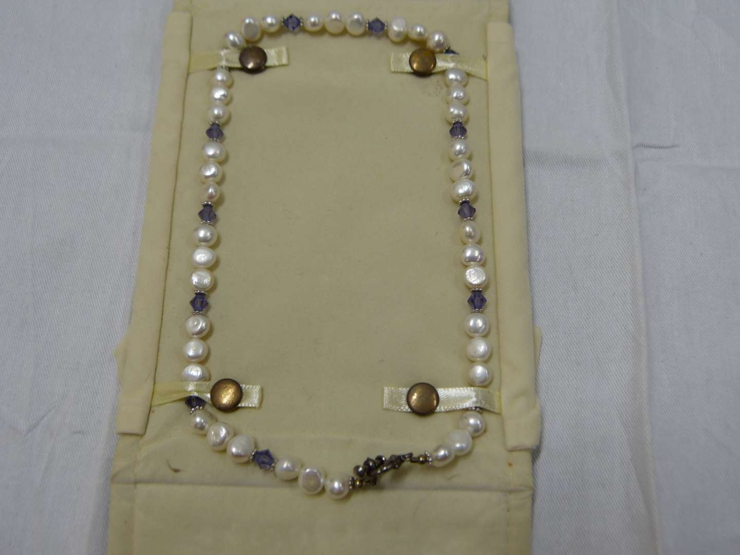 """Lot # 67  Fresh water pearls 18"""" accented with amethyst colored stones"""