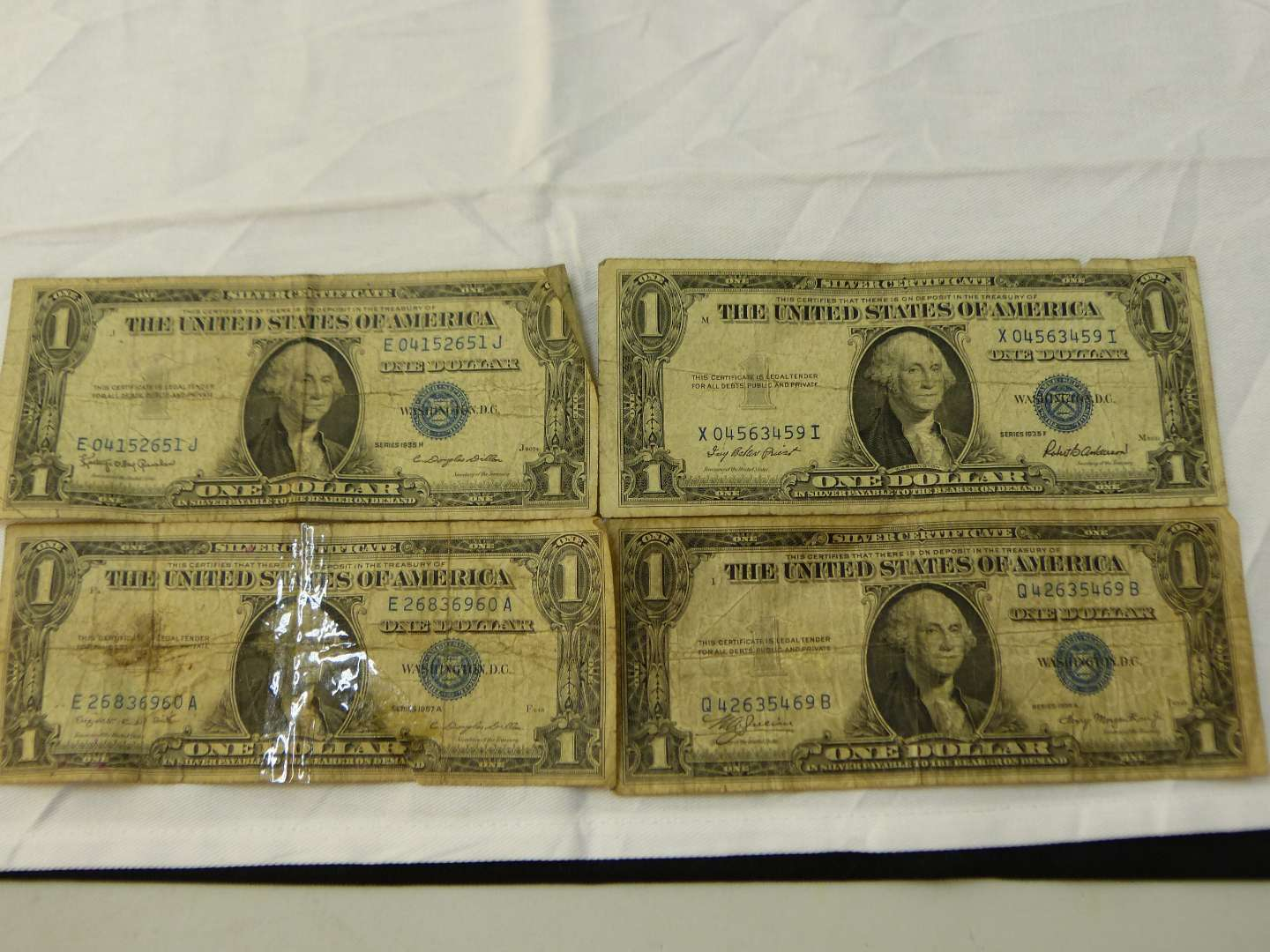 Lot # 107  4 US $1 silver certificates various conditions