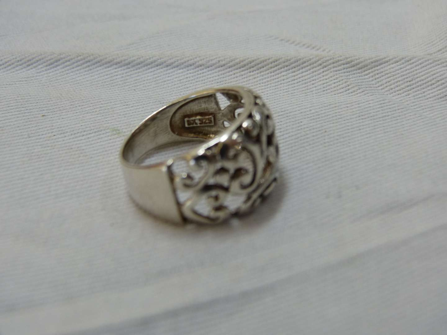 Lot # 127  Sterling silver reticulated size 8 ring