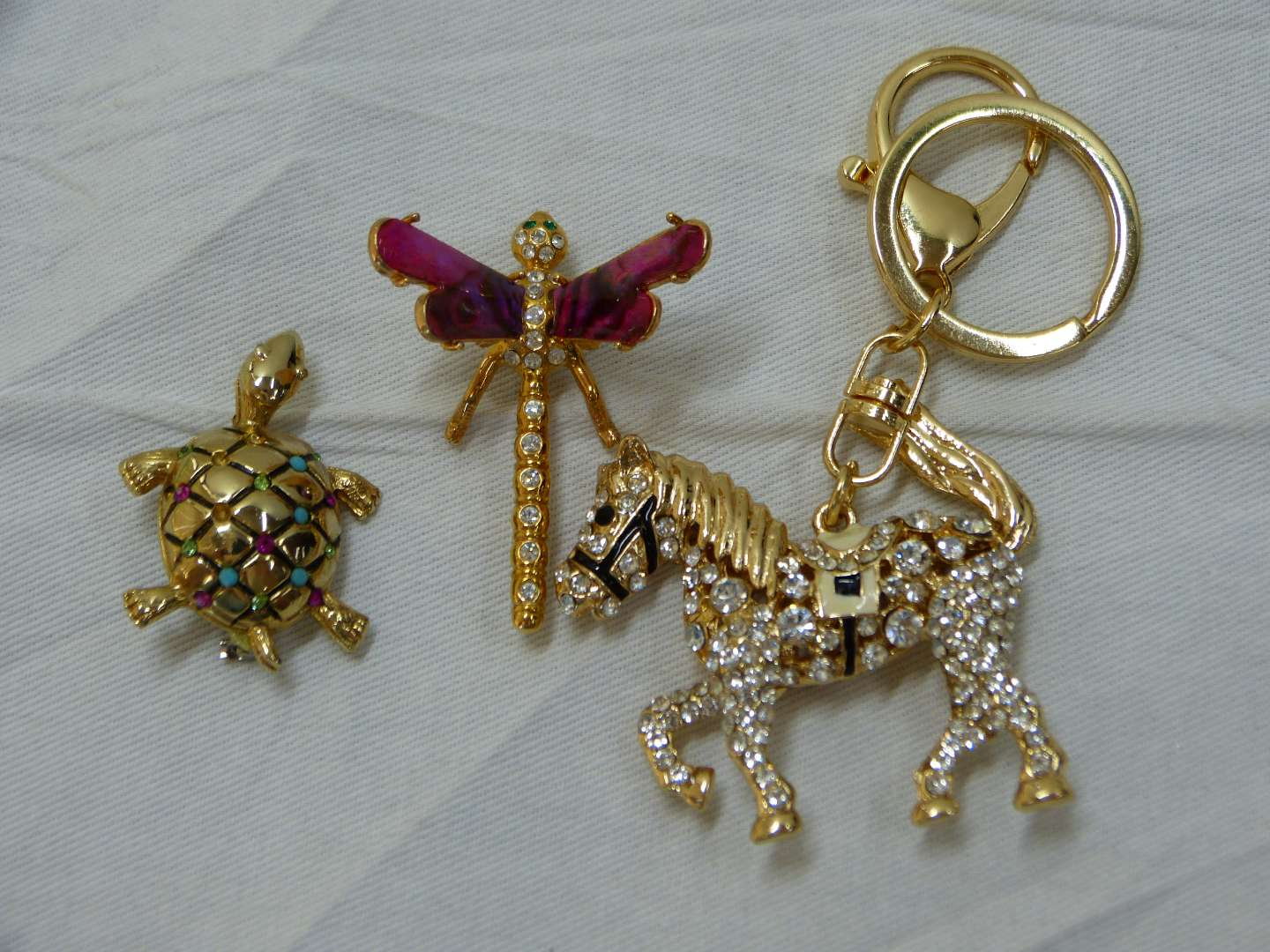 Lot # 138  BLING lot of brooches & key chain