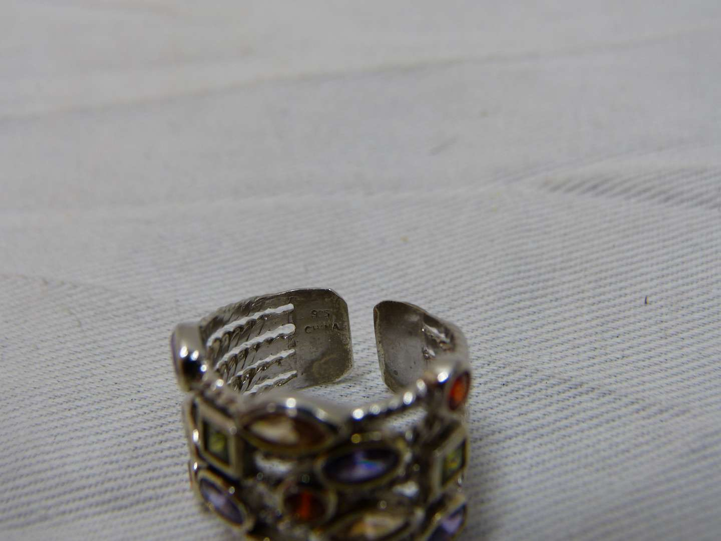 Lot # 199   Sterling silver & multi stones size 7 ring