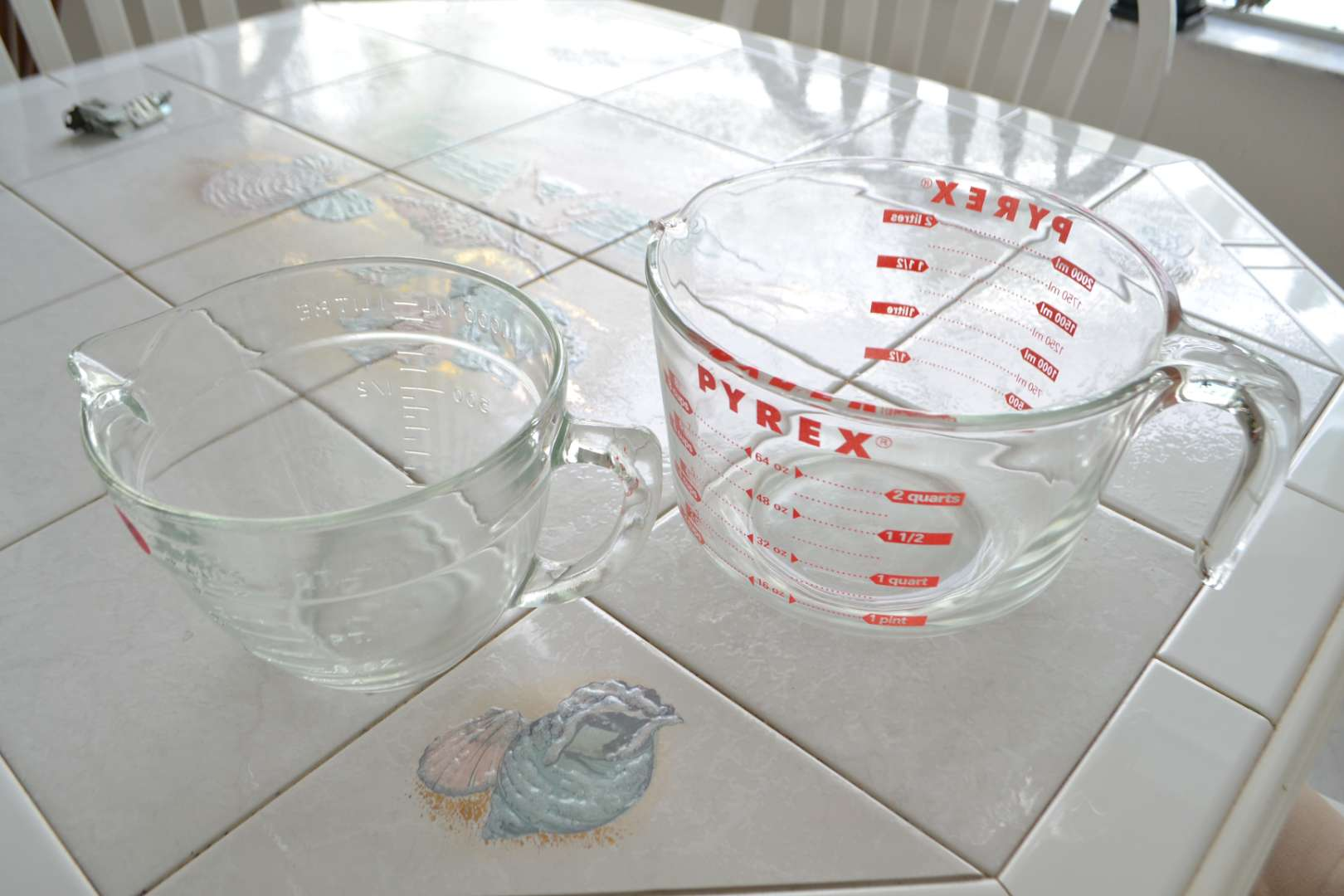 Lot # 55 TWO GLASS MEASURING CUPS
