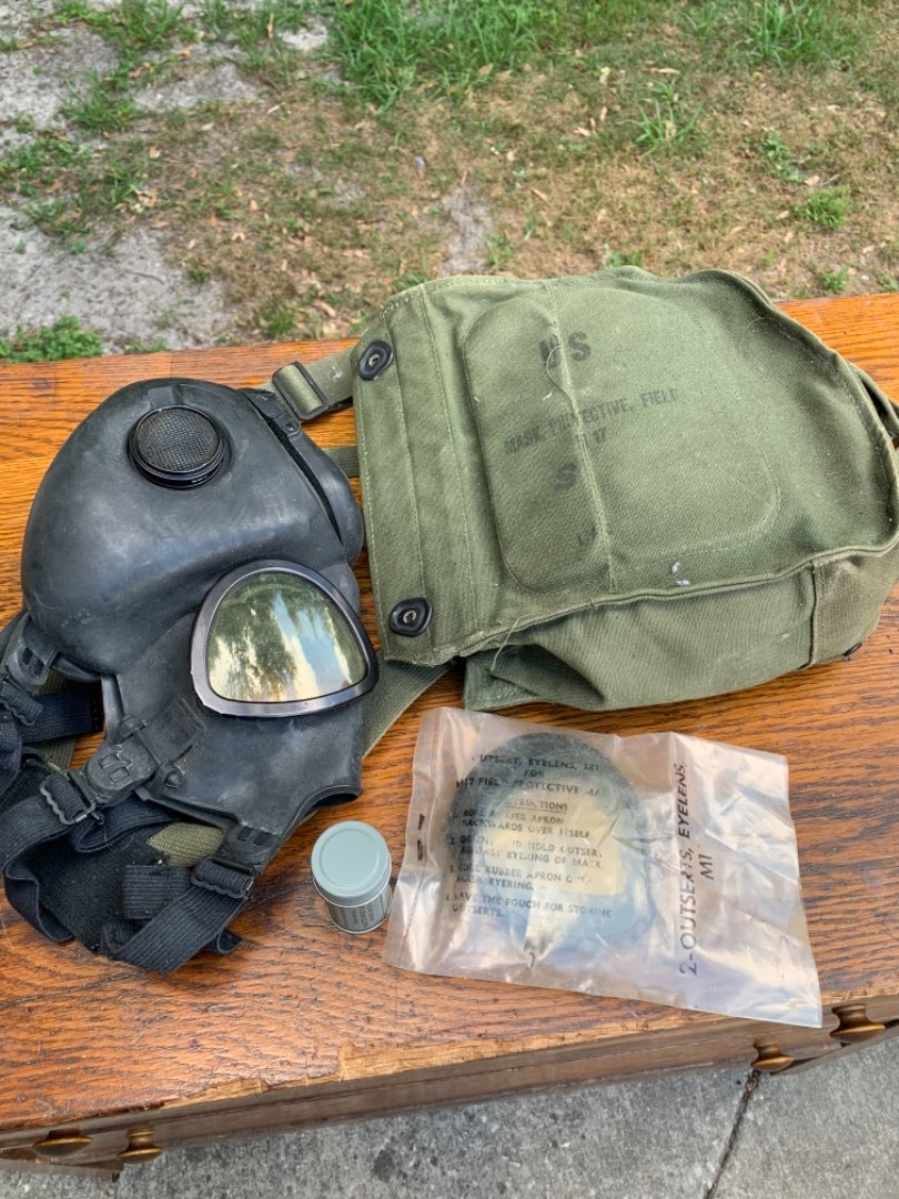 Lot # 37  Vintage US Military Gas Mask With Extras.