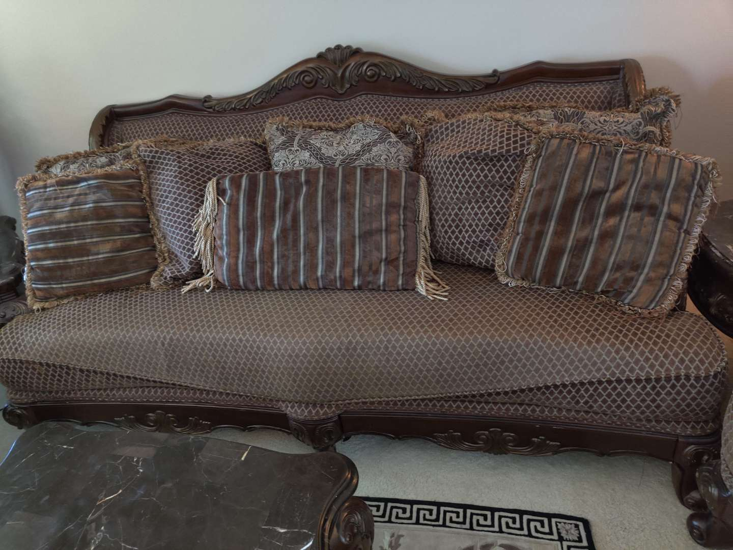 #1. high dollar carved wood sofa with pillows
