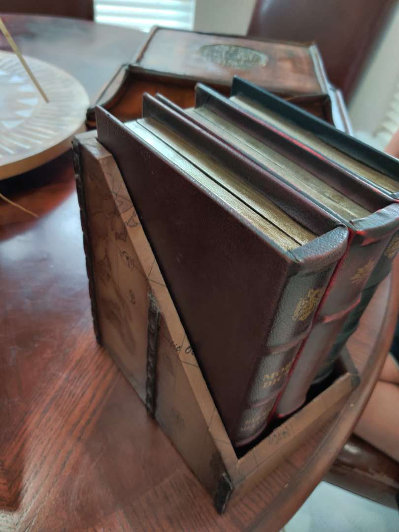 57 set of three storage boxes that look like books
