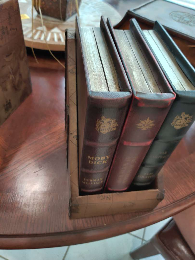 58 set of three storage boxes that look like books