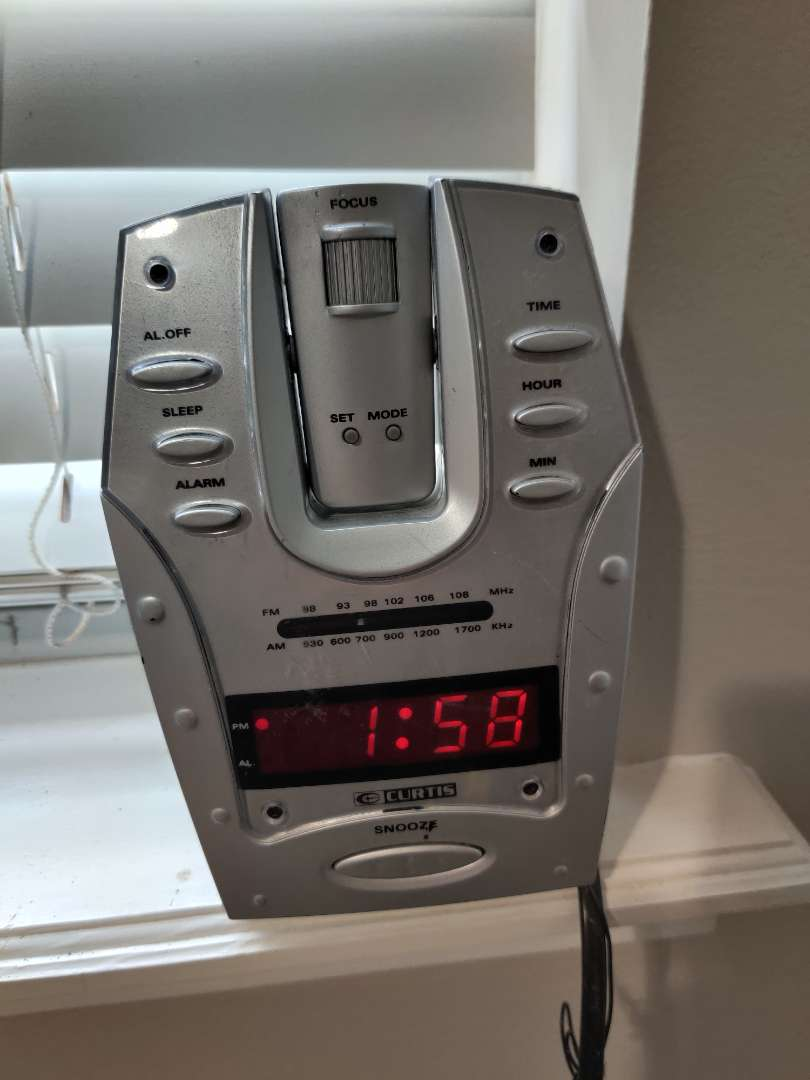 64 Curtis radio that projects the time on to the ceiling clock radio