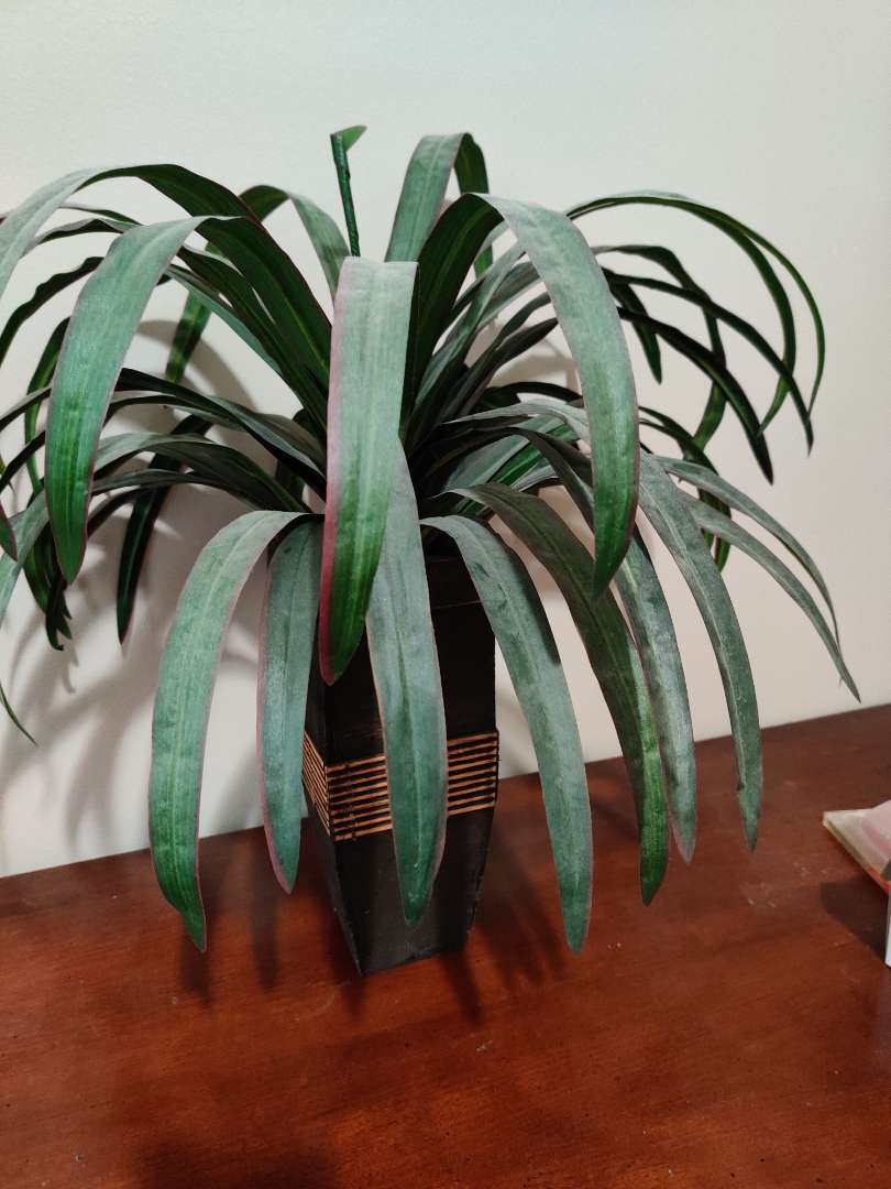 67 decorative faux plant in vase