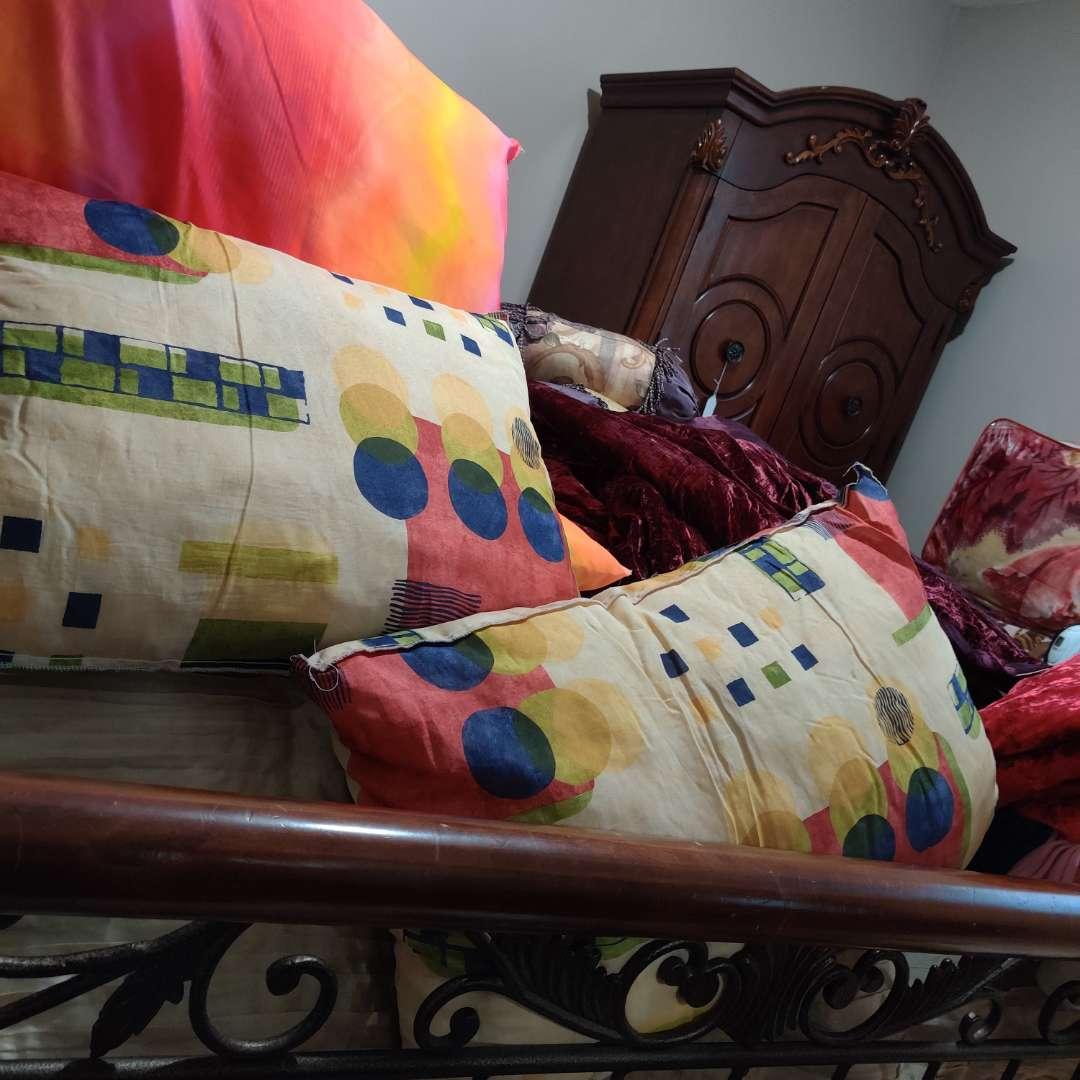 109 lot of four pillows pink orange yellow