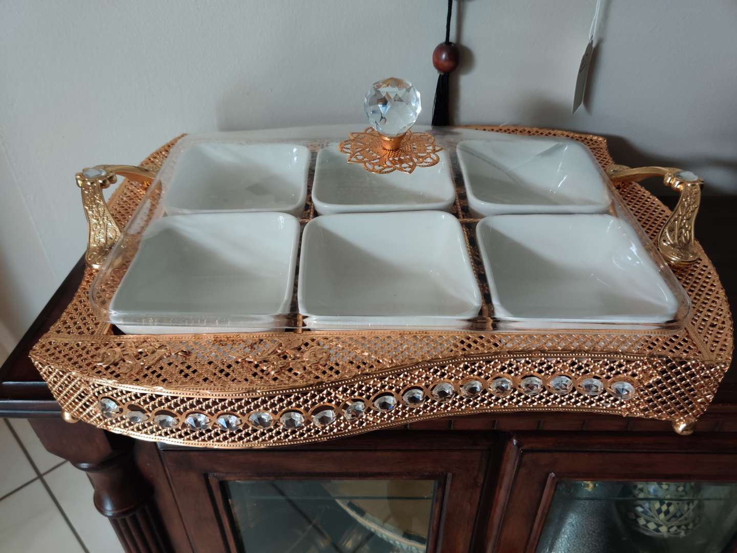 202 elegant serving dish jeweled gold with plastic cover 20 in long Nice condition
