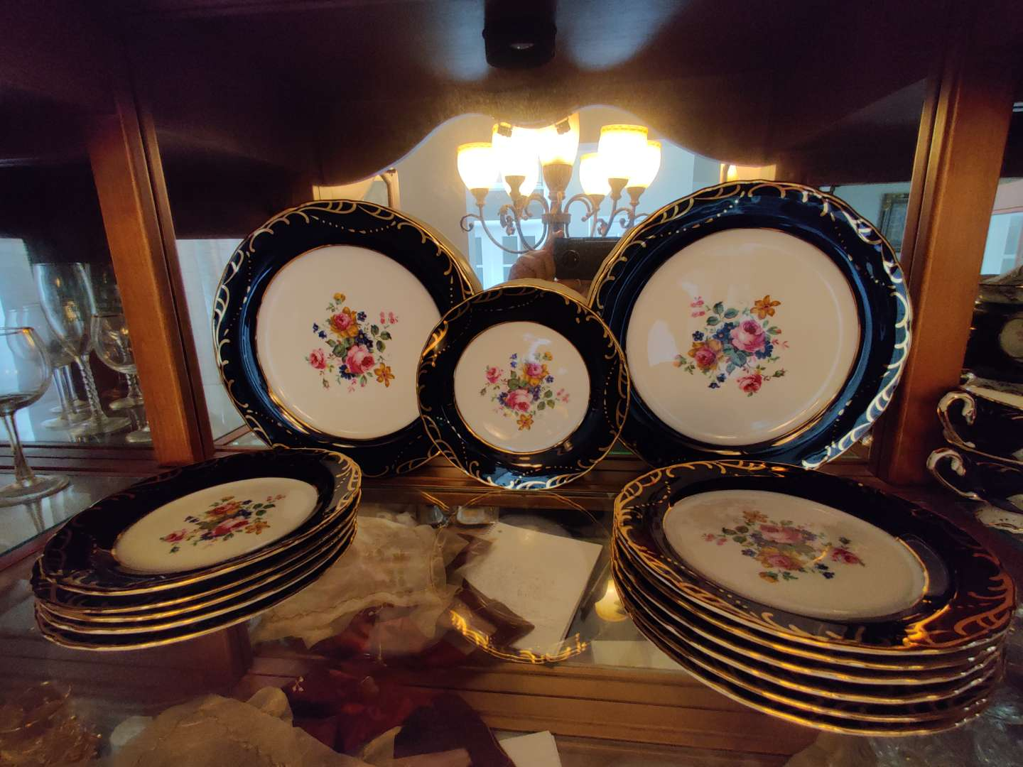 218 set of 14 pieces of blue and gold fine china two dinner plates and 12 salad plates