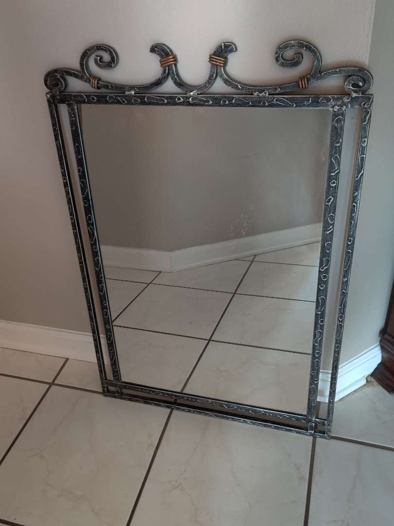 227 very nice metal mirror that would go real good with the foyer table