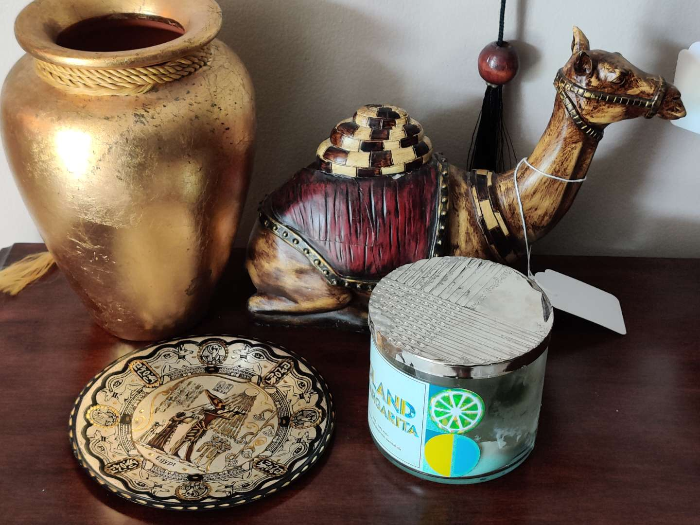 229 lot of four pieces metal plate candle vase and damaged camel missing foot
