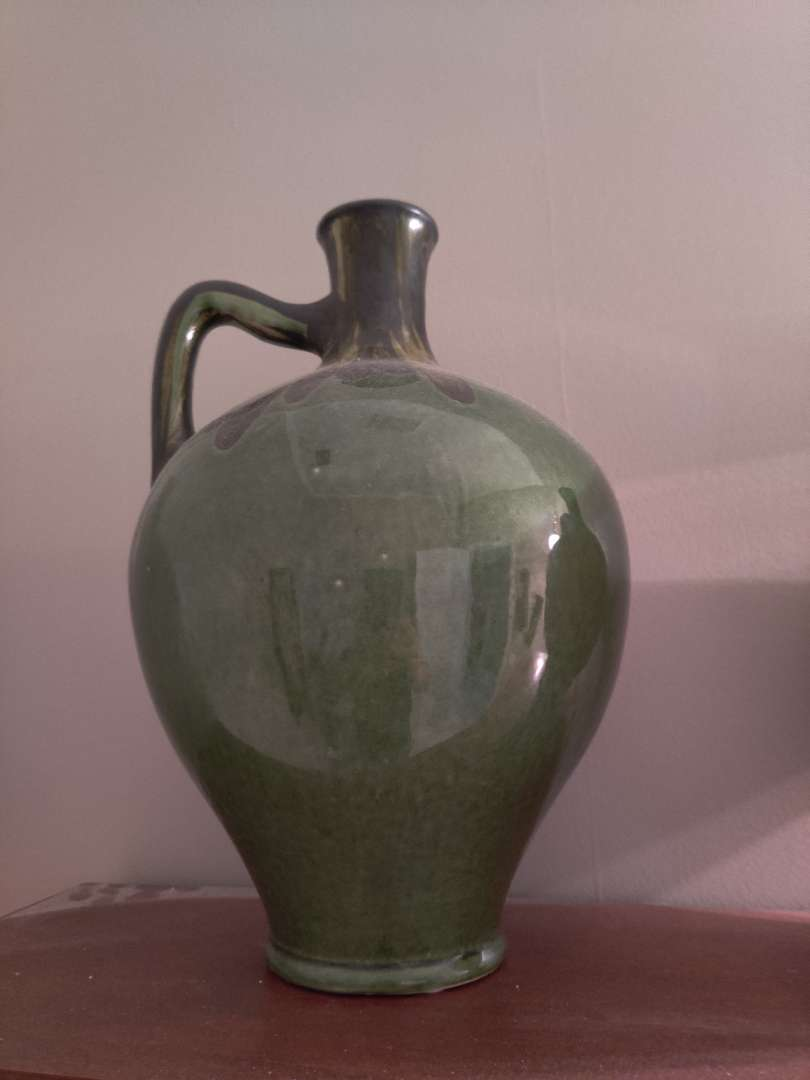 268 green decorative jug with handle 14 inches tall $50 price tag