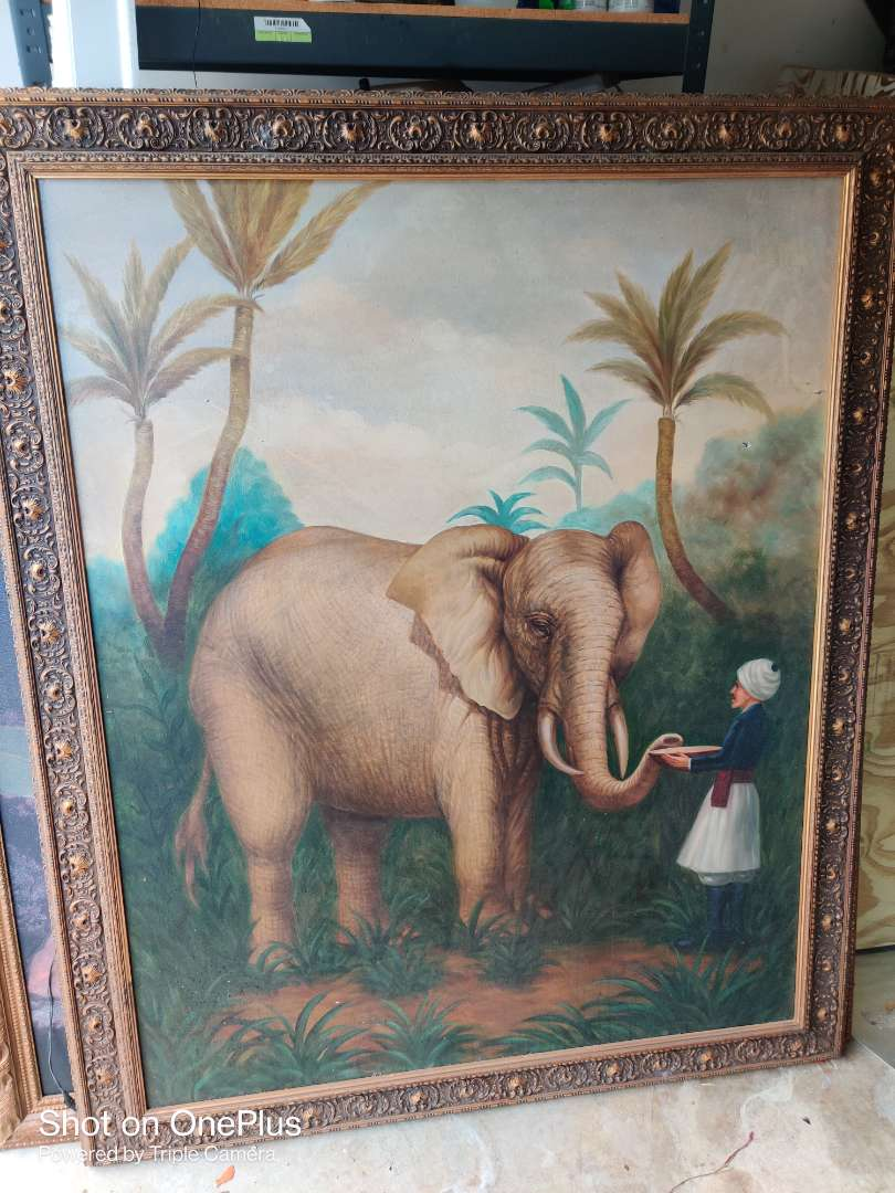 383 large elephant picture art on canvas 47 in x 58 in does have one small hole in it