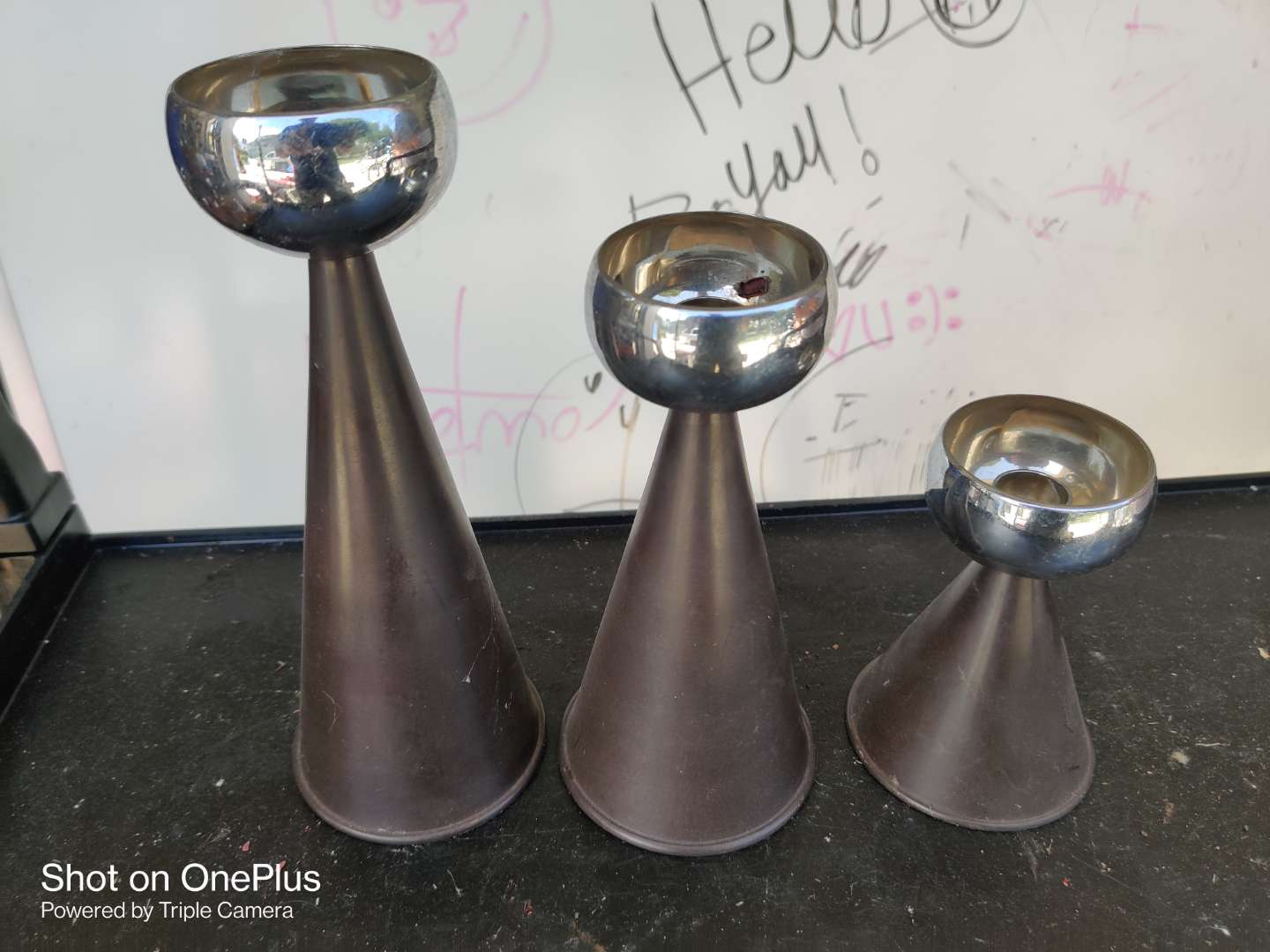 438 all of three candle holders tallest is 10 inches and they are very heavy metal