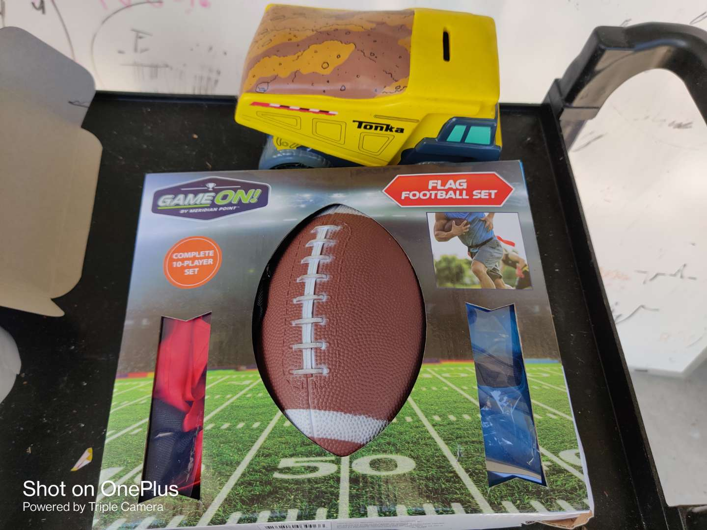 444 two pieces flag football set flags and ball and a Tonka truck Bank porcelain