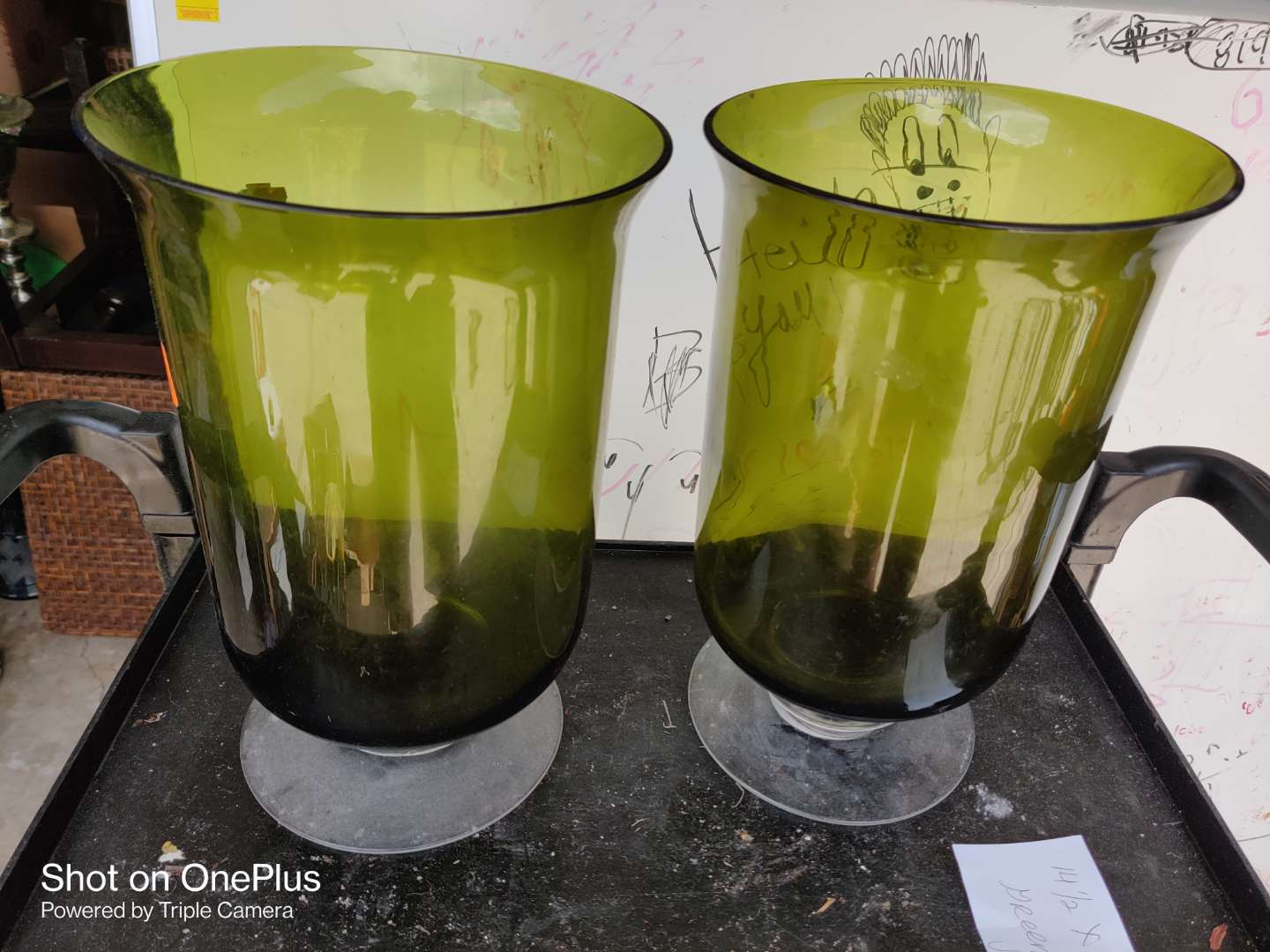 459 pair of green hurricane vases 14 1/2 in by 8 1/2 in great condition