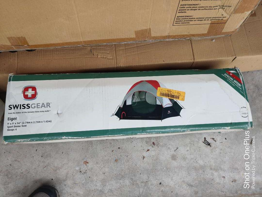 511 Swiss gear tent in box still sealed 9 ft by 9 ft by 5 ft 6 dome tent