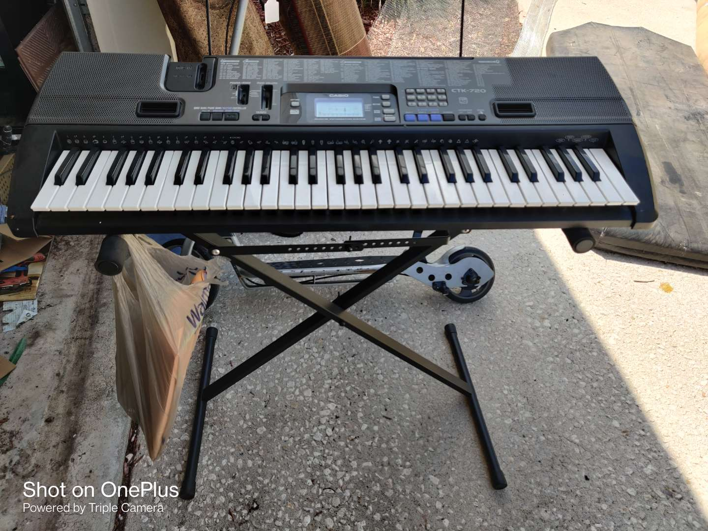 513 Casio keyboard and stand model ctk 720 with book works