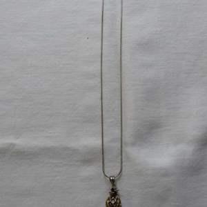 Lot # 181  Sterling silver necklace w/egg shape pendant