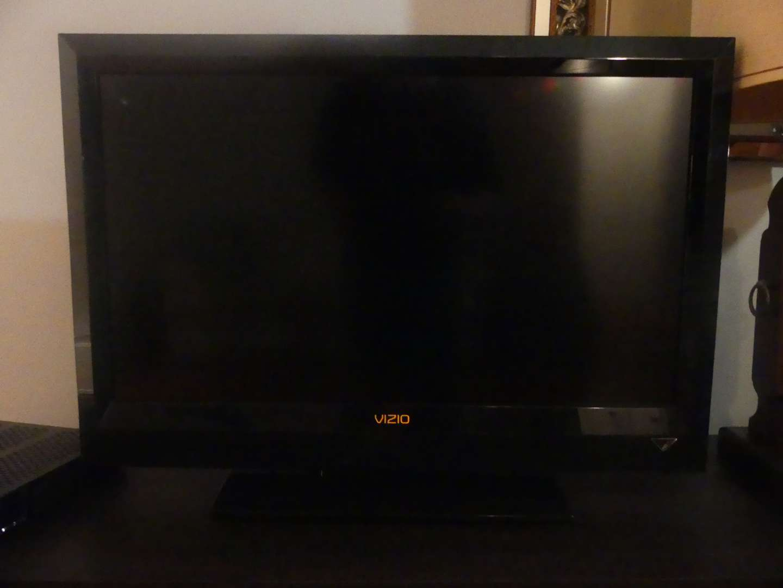 "Lot #63 2010 Vizio 320VL 32"" 720p LCD HDTV with Stand"
