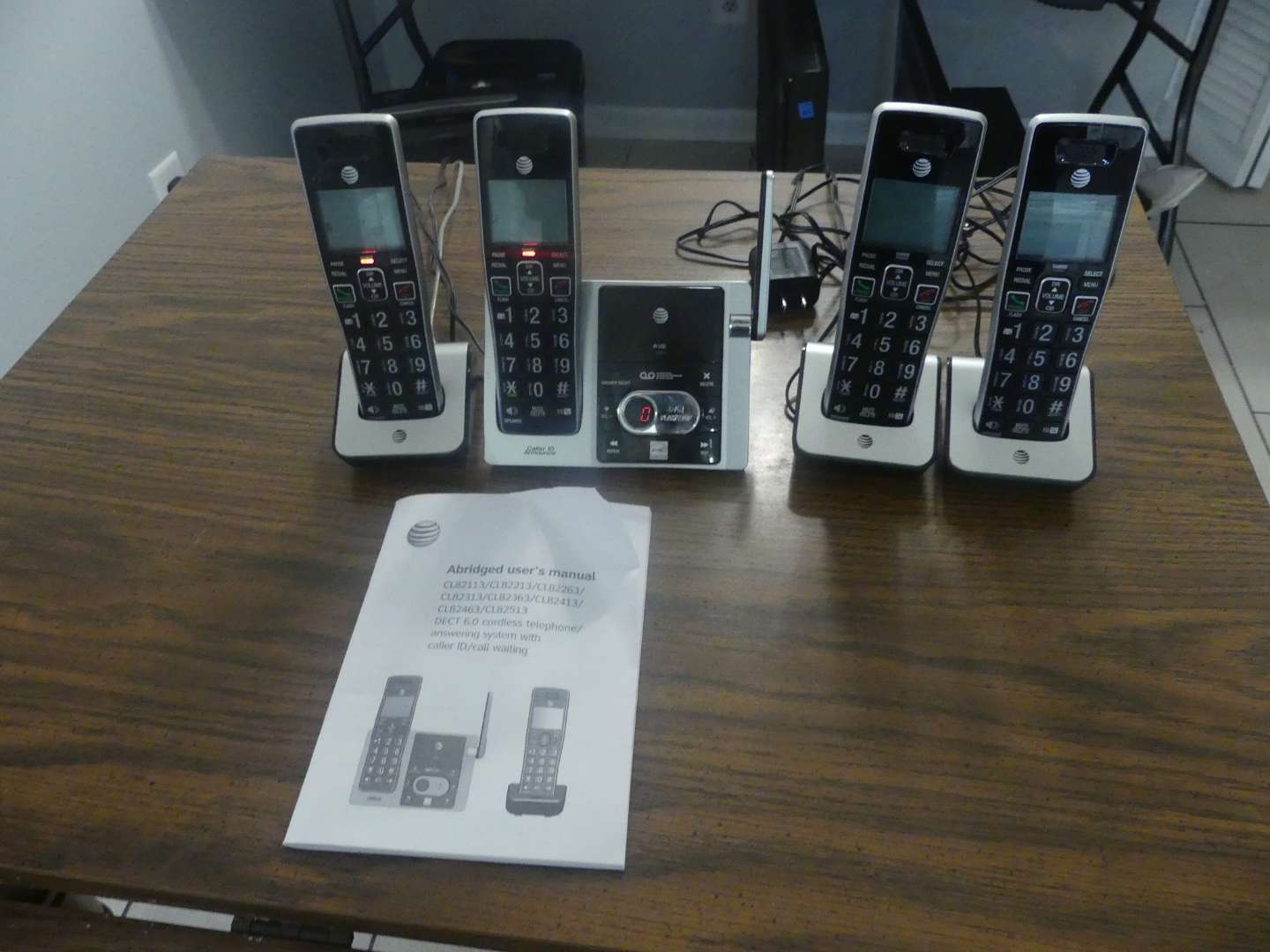 Lot #77 AT&T CL82413 Cordless Phone/Answering Machine with 3 Additional Handsets