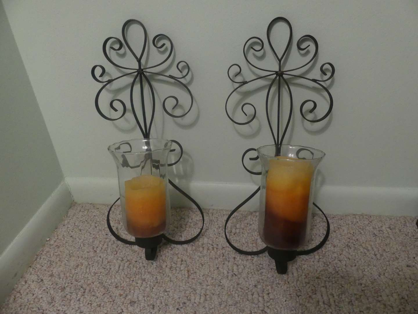 Lot #98 Curled Black Metal Wall Sconces with Large Pillar Glass