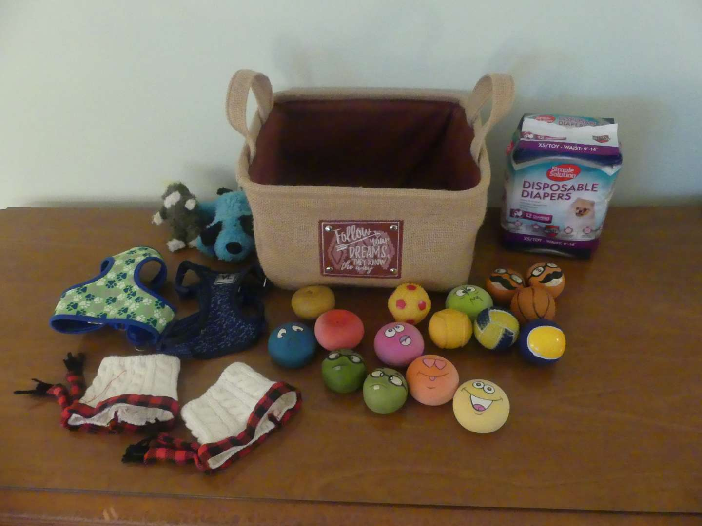 Lot #116 Misc. Small Dog Clothes and Toys in Cloth Bin