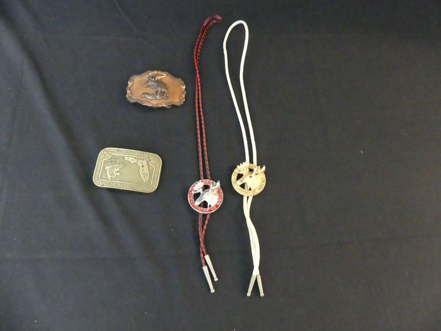 Lot #157 Loyal Order of Moose Belt Buckles and Bolo Ties