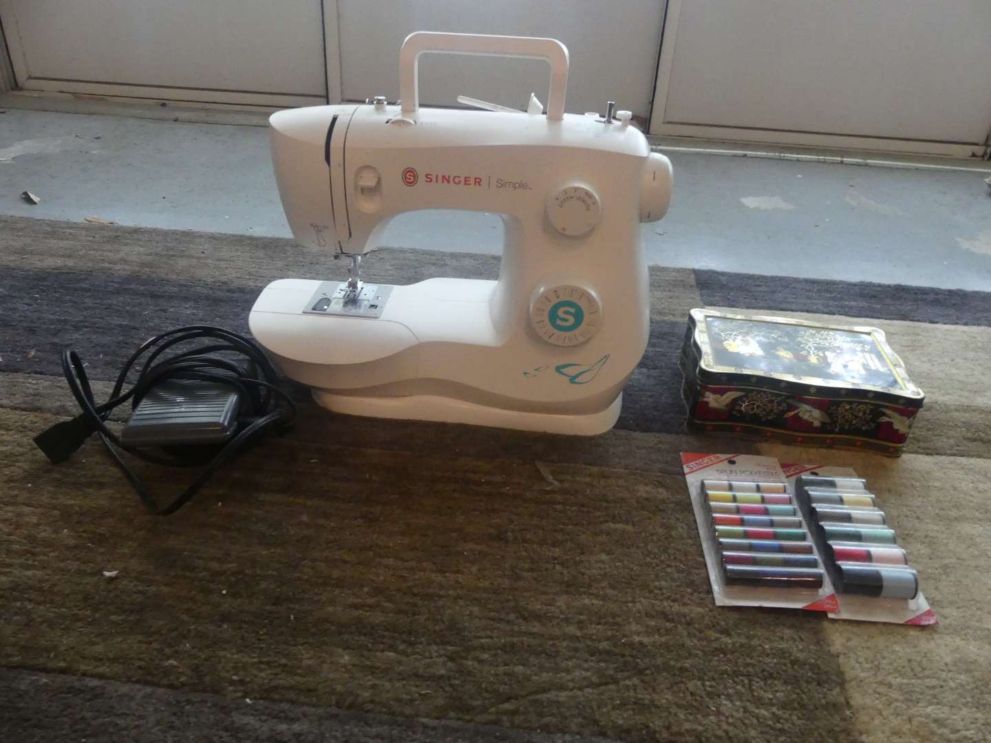 Lot #174 Singer   Simple Sewing Machine with Tin of Sewing Supplies