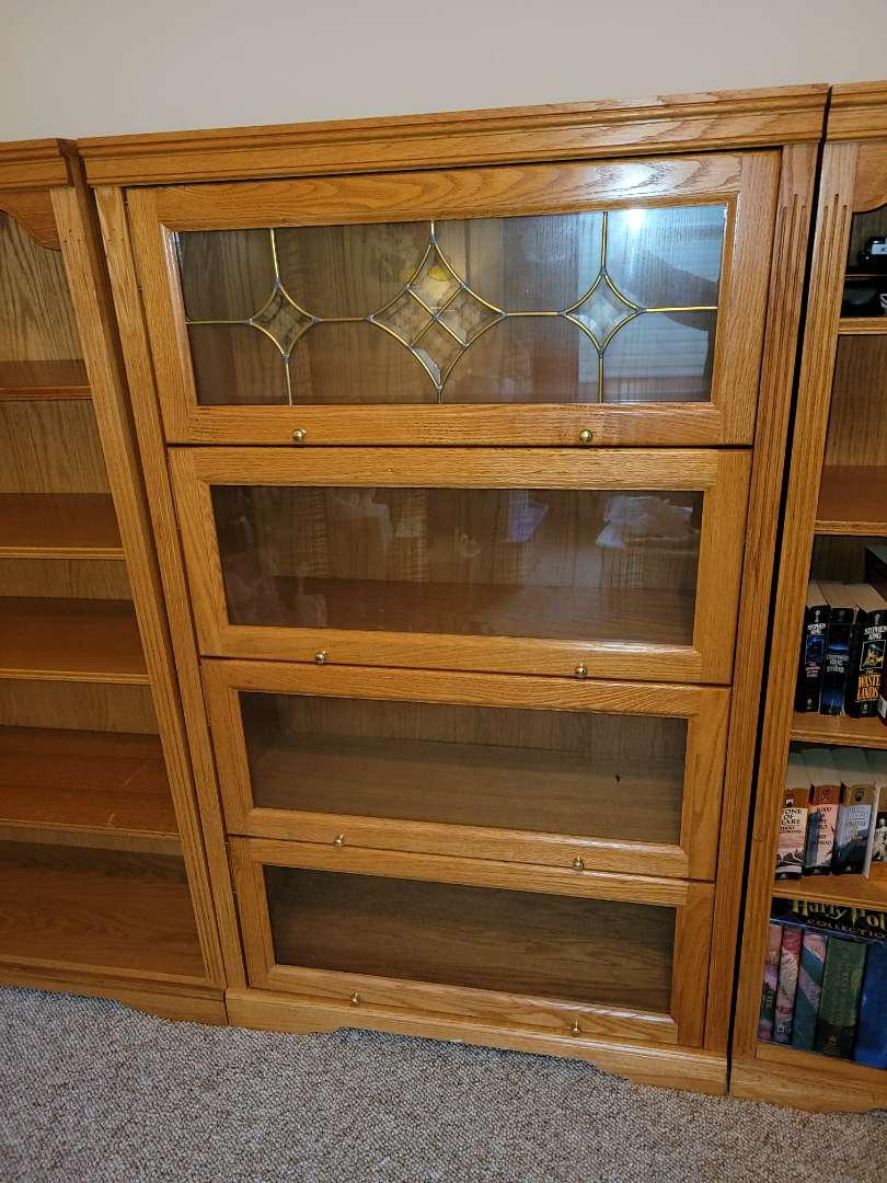 Lot # 84 Wood 5'x3' Bookshelf/Display Cabinet w/ Glass Sliding Doors