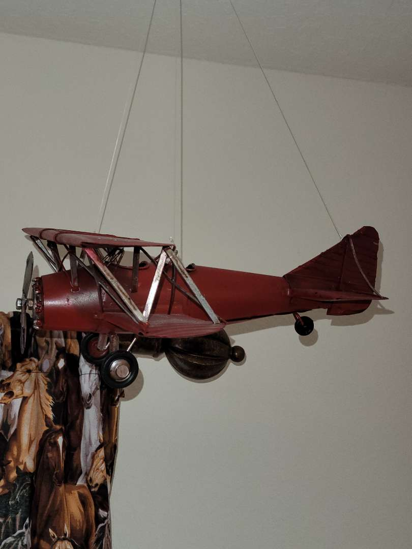Lot # 399 Red Metal Model Airplane