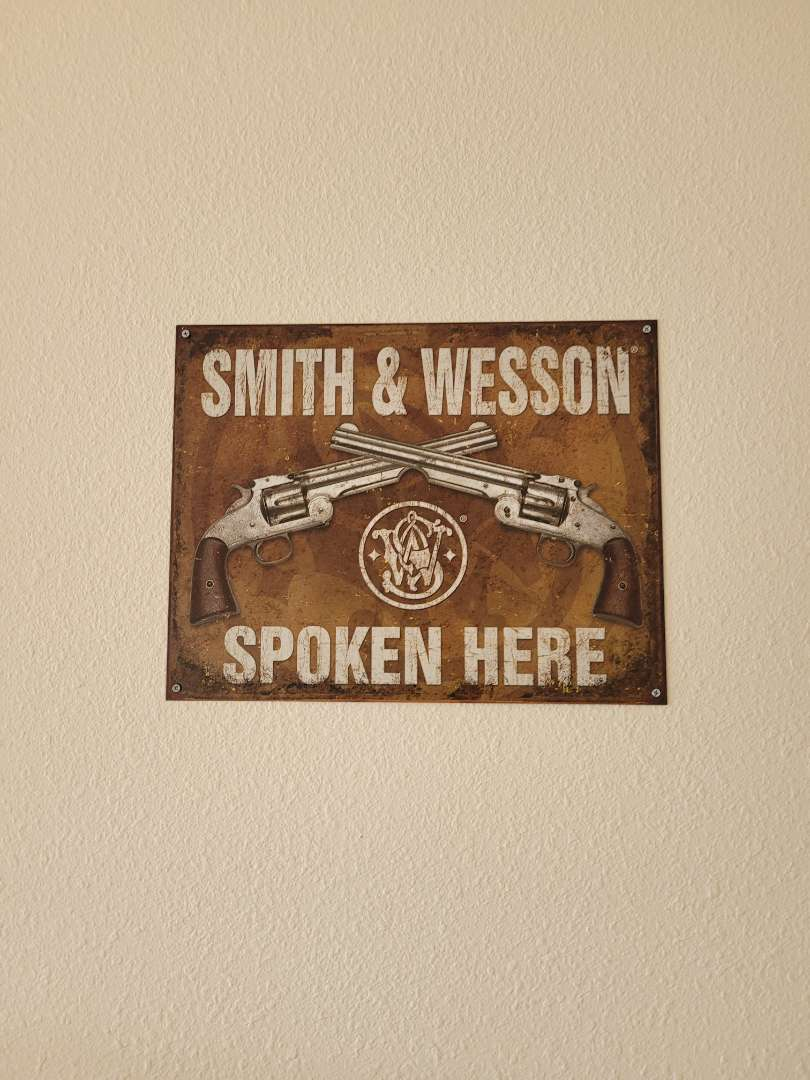 Lot # 404 Smith & Wesson Metal Sign