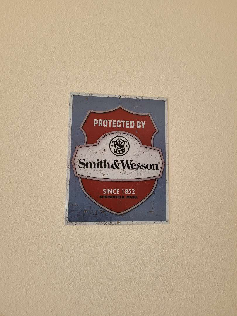 Lot # 405 Smith & Wesson Metal Sign