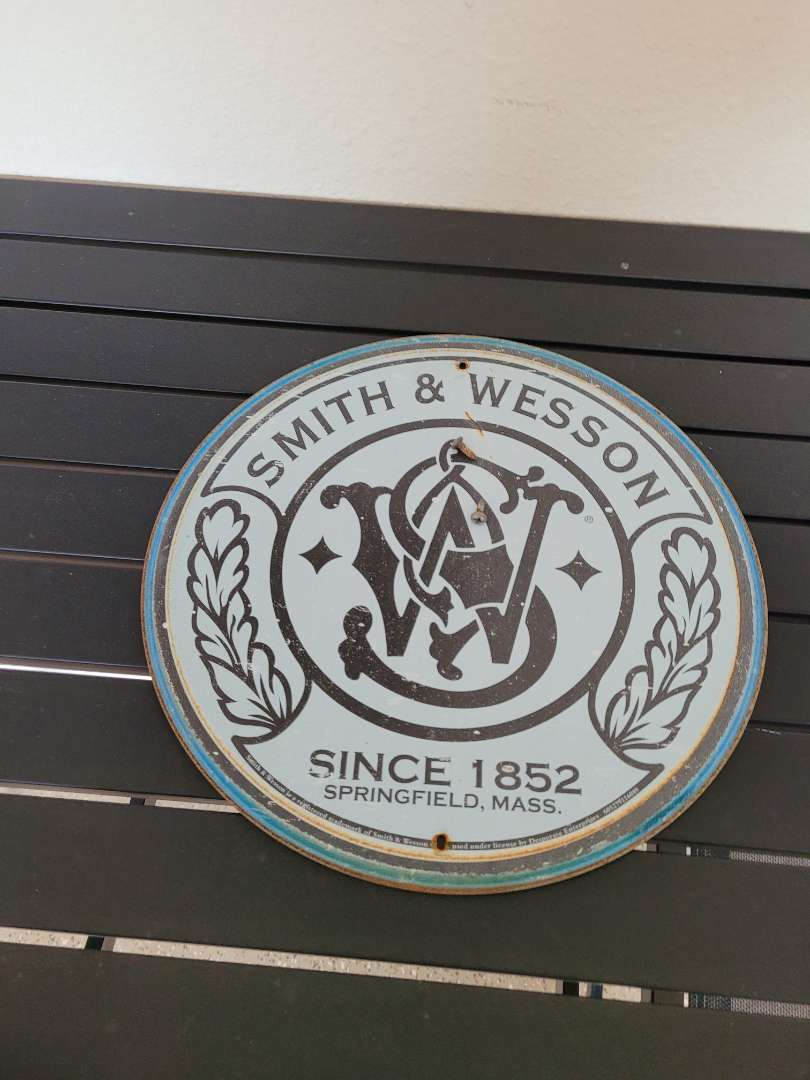 Lot # 408 Smith & Wesson Metal Sign