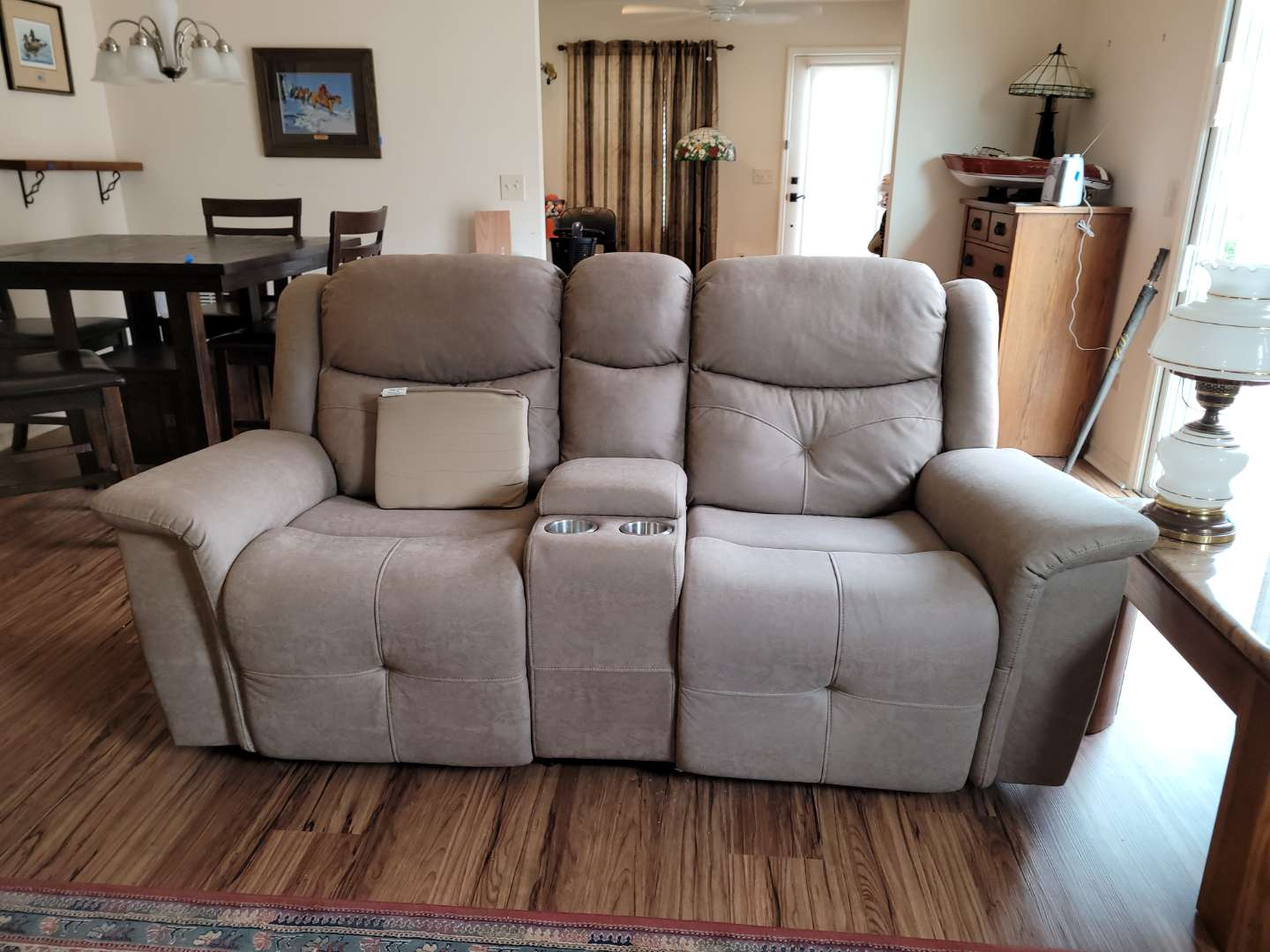 Lot # 490 New Classic Furniture Duel Reclining Love Seat w/ Storage & Cup Holders