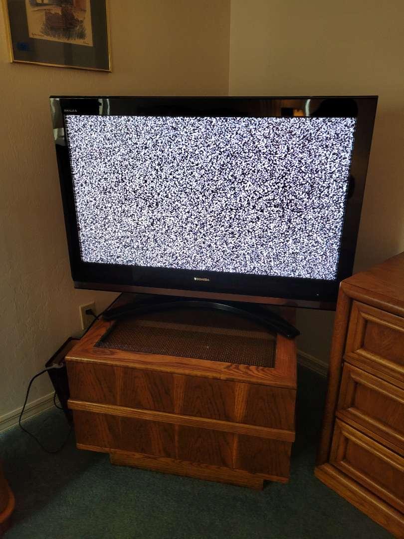 "Lot # 54 Toshiba 42"" Flatscreen TV on Swivel Stand"