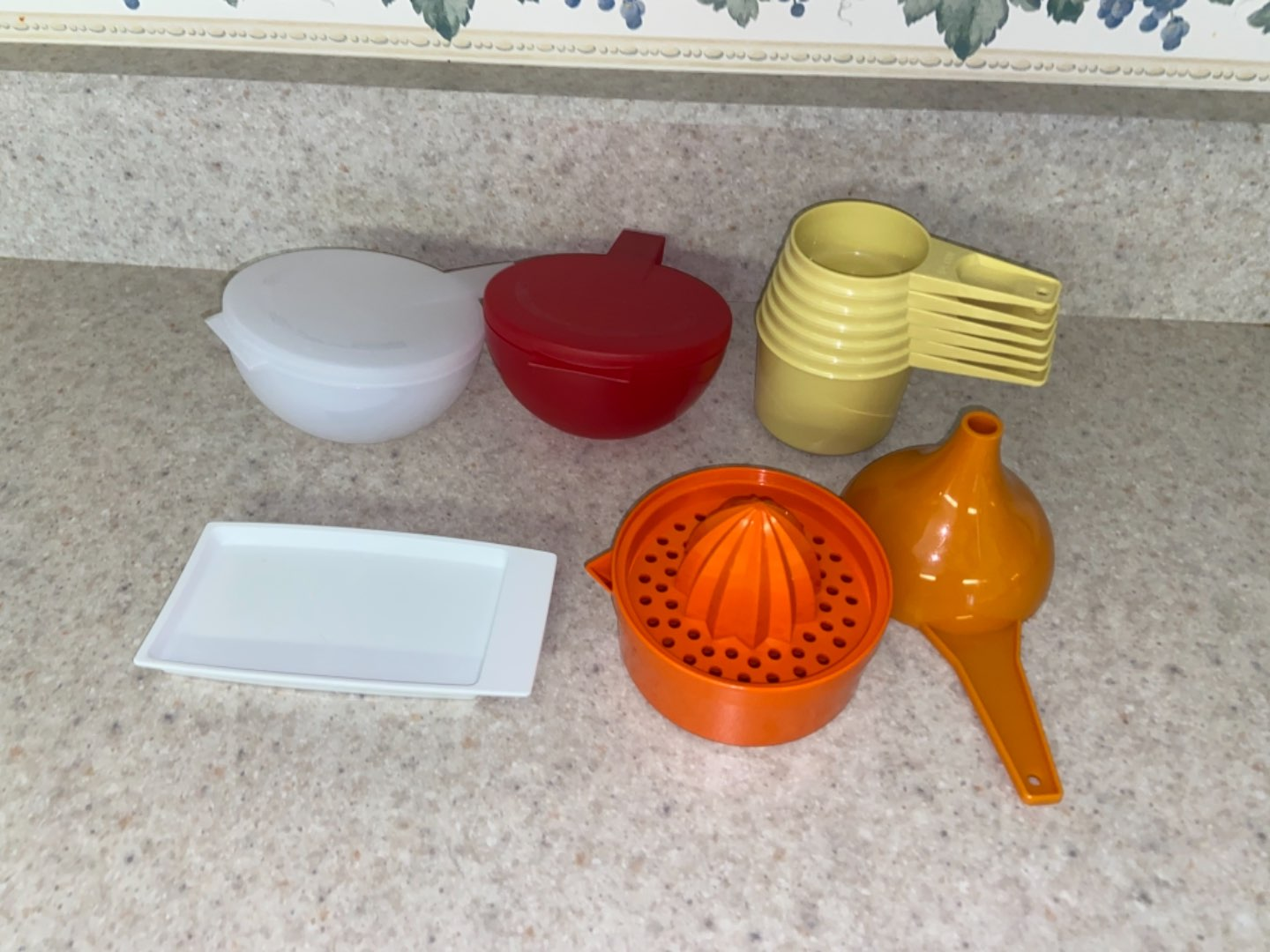 Lot # 149 Tupperware (measuring cups, funnel & more)