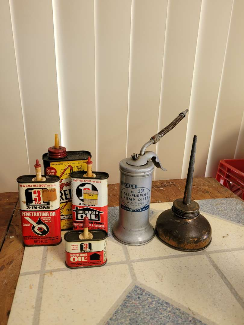 Lot # 402  Vintage Oil Cans