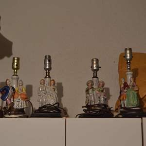 """Lot # 25 FOUR LAMPS EACH ABOUT 12"""" TALL"""
