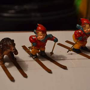 Lot # 41 THREE SKIERS VERY HEAVY ABOUT TWO INCHES TALL