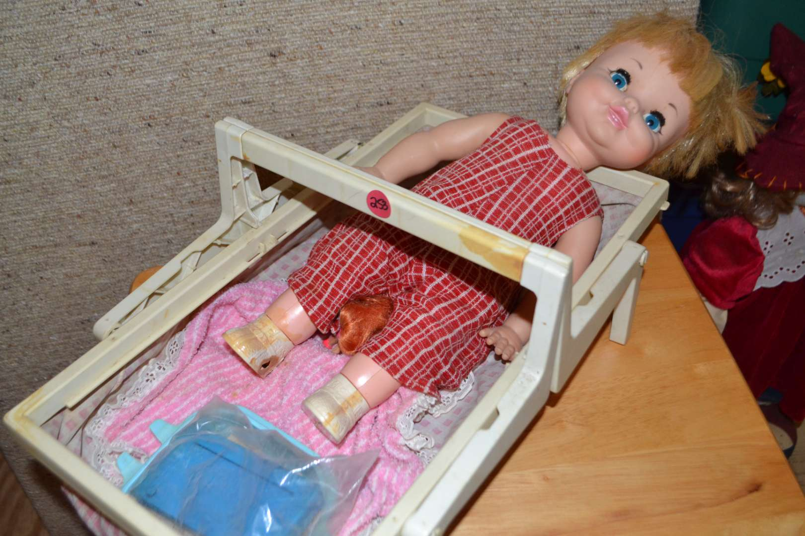 Lot # 253 DOLL WITH CARRIER